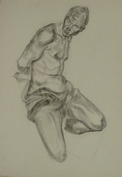 Student charcoal drawing of a kneeling figure