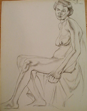 Student charcoal drawing of a seated female nude